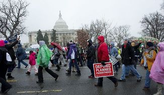** FILE ** In this Jan. 23, 2012, file photo, pro-life advocates march past the Capitol during the annual March for Life in Washington, D.C. (Barbara L. Salisbury/The Washington Times)
