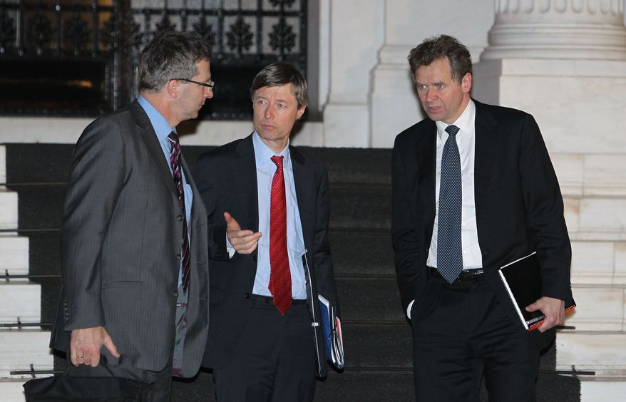 Poul Thomsen (right), the International Monetary Fund mission chief in Greece, European Commission official Matthias Mors (center) and Klaus Masuch of the European Central Bank leave Maximou mansion in Athens on Jan. 20, 2012, after a meeting with Greek Prime Minster Lucas Papademos. (Associated Press)