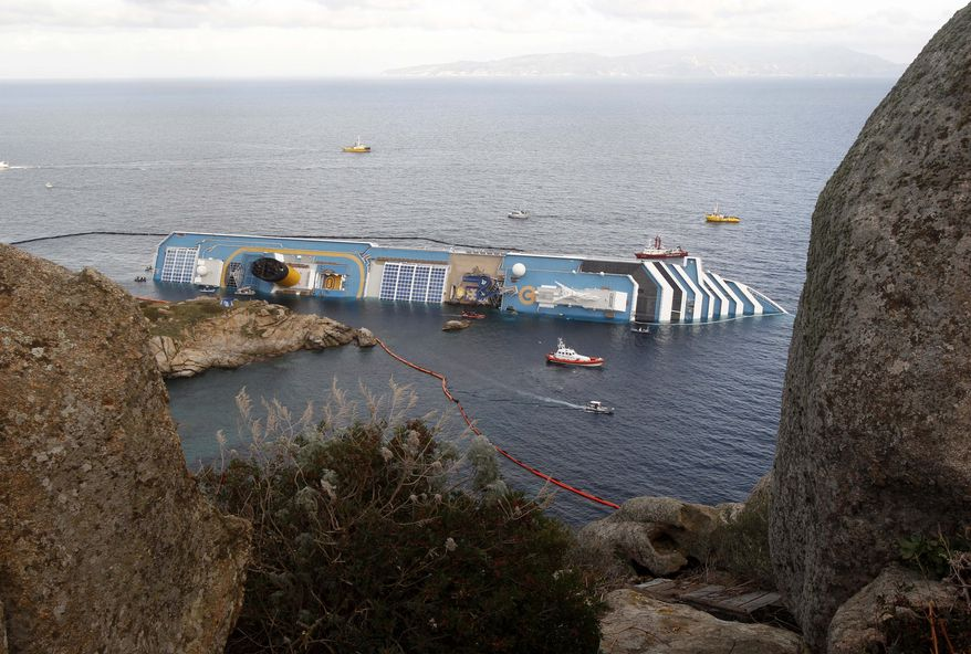 The cruise ship Costa Concordia lies on its side off the Tuscan island of Giglio, Italy, on Sunday, Jan. 22, 2012.  (AP Photo/Pier Paolo Cito)