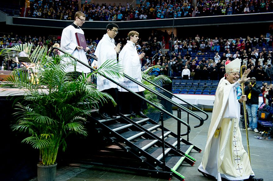 Archbishop of Washington, Donald Wuerl, waves to the crowd as he exits the stage following the celebration of mass at the Youth Rally and Mass for Life at the Verizon Center in Washington, D.C. on Monday, Jan. 23, 2012. (Barbara L. Salisbury/The Washington Times)