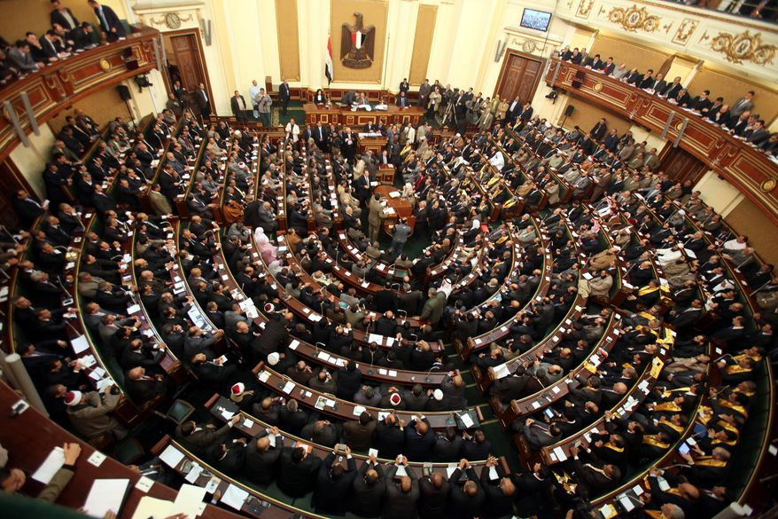 The parliament elected in Egypt's first legislative vote after President Hosni Mubarak's ouster nearly a year ago holds its inaugural session on Monday, Jan. 23, 2012, in Cairo. (AP Photo/Khaled Elfiqi, Pool)