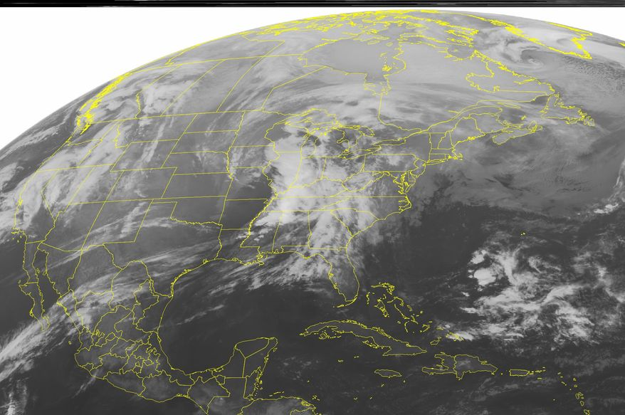 A NOAA satellite image taken on Monday, Jan. 23, 2012, at 12:45 a.m. EST shows widespread cloud cover as a strong low-pressure system moves through the mid-Mississippi and western Ohio valleys. (AP Photo/Weather Underground)