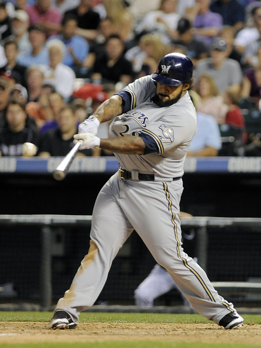 ** FILE ** In this July 15, 2011, file photo, Milwaukee Brewers' Prince Fielder hits a double during the seventh inning of a baseball game against the Colorado Rockies in Denver. (AP Photo/Chris Schneider, File)