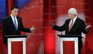 Former Massachusetts Gov. Mitt Romney (left) and former House Speaker Newt Gingrich gesture during a Republican presidential candidate debate on Monday, Jan. 23, 2012, at the University of South Florida in Tampa, Fla. (AP Photo/Paul Sancya)