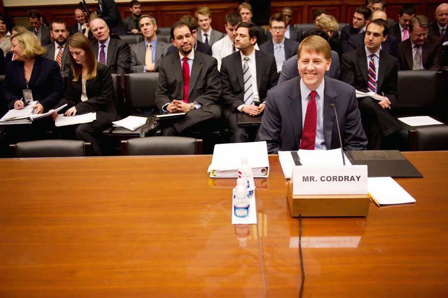 """""""Look, in my lifetime the single thing that hurt people most was the financial crisis,"""" Consumer Financial Protection Bureau Director Richard Cordray tells the House Committee on Oversight and Government Reform. """"I think we can help head that off in the future."""" (Andrew Harnik/The Washington Times)"""