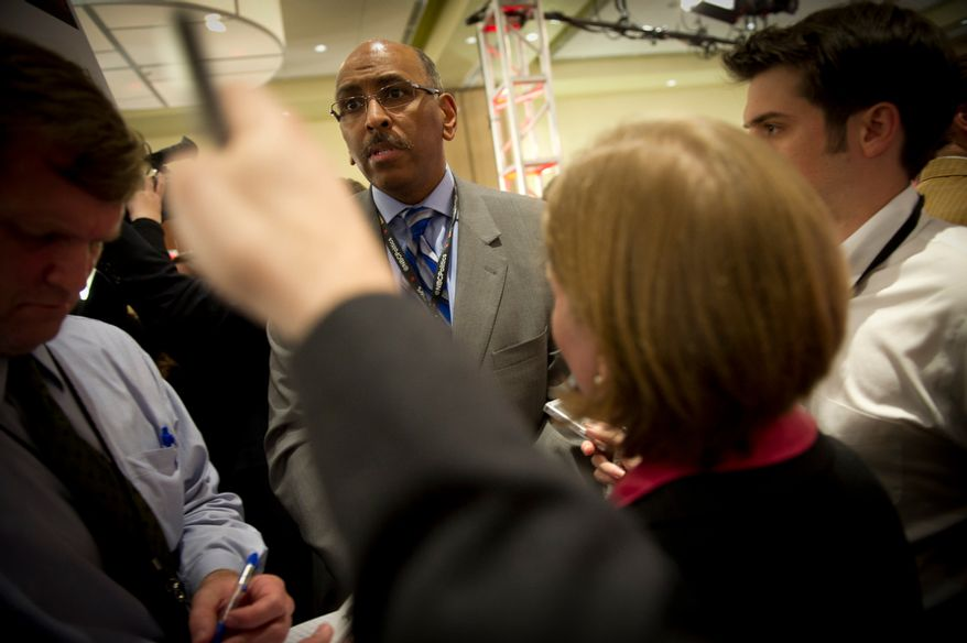 Former Maryland Lt. Governor Michael Steele talks with reporters in the spin room following the Republican Candidates Debate at the University of South Florida in Tampa, Fla., Monday, January 23, 2012. (Rod Lamkey Jr/ The Washington Times)