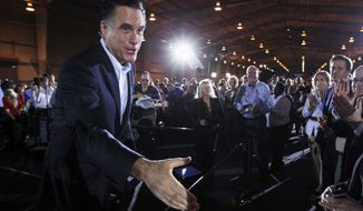 Republican presidential candidate, former Massachusetts Gov. Mitt Romney, greets audience members after speaking at the National Gypsum Company in Tampa, Fla., Tuesday, Jan. 24, 2012. (AP Photo/Charles Dharapak)