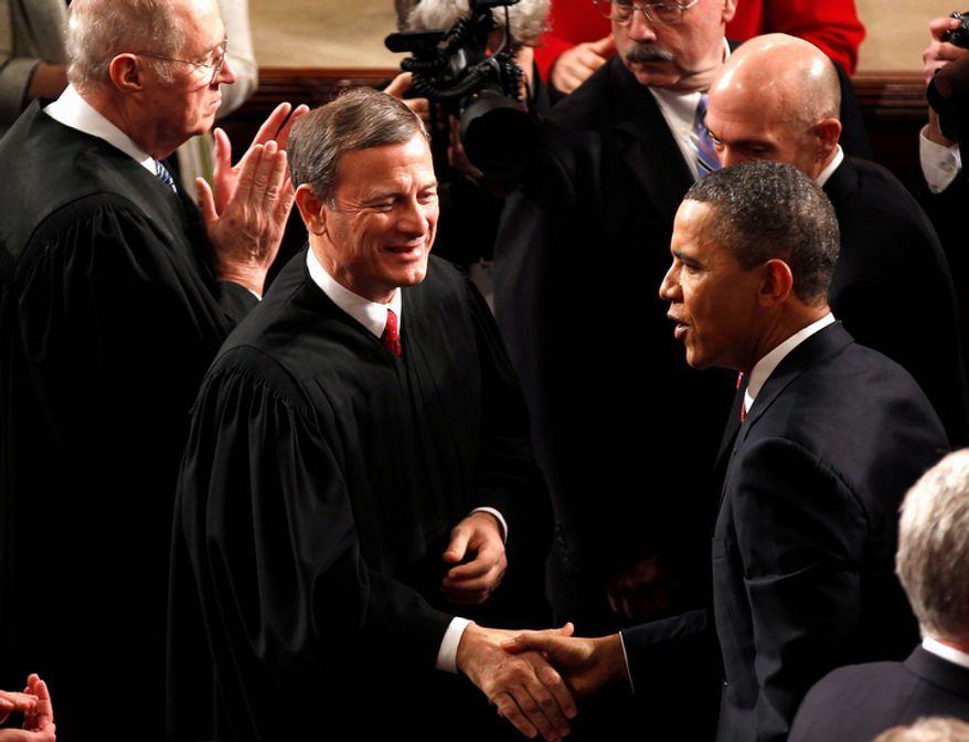 Supreme Court Chief Justice John Roberts greets President Barack Obama on Capitol Hill, prior to the president's State of the Union address. (AP Photo/J. Scott Applewhite)