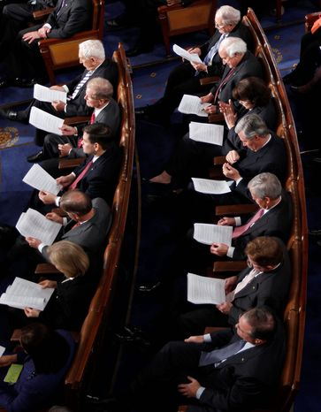 Members of Congress read along as President Barack Obama delivers his State of the Union address. (AP Photo/Evan Vucci)