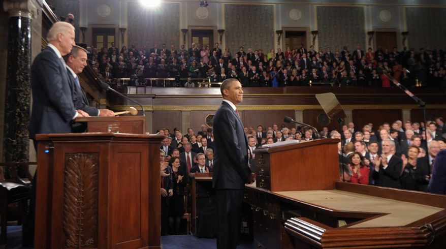 President Barack Obama pauses before he delivers his State of the Union address on Capitol Hill. At left are Vice President Joe Biden and House Speaker John Boehner. (AP Photo/Saul Loeb, Pool)