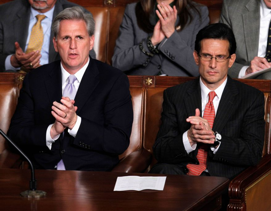 House Majority Whip Kevin McCarthy of Calif., left, and House Majority Leader Eric Cantor of Virginia applaud during President Barack Obama's State of the Union address. (AP Photo/Evan Vucci)