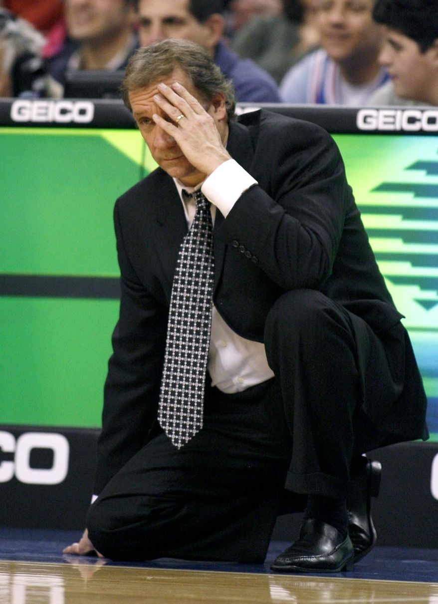 Washington Wizards coach Flip Saunders watches as his team plays against the Philadelphia 76ers in the first half of an NBA basketball game Monday, Jan, 23, 2012, in Philadelphia. (AP Photo/H. Rumph Jr. )