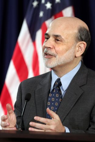 Federal Reserve Chairman Ben Bernanke takes part in a news conference at the William McChesney Martin Federal Reserve Board Building in Washington, Wednesday, Jan. 25, 2012, following the January Federal Open Market Committee meeting. (AP Photo/Jacquelyn Martin)