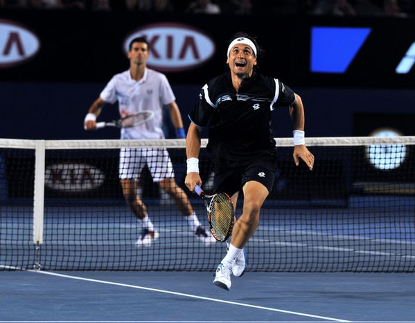 David Ferrer chases down a ball during his quarterfinal loss to Novak Djokovic at the Australian Open. Djokovic next will play Andy Murray in a rematch of last year's final. (Associated Press)