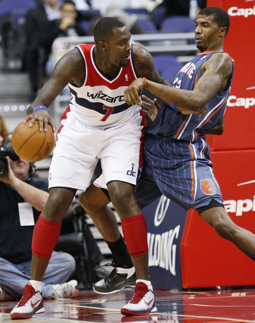 Washington Wizards forward Andray Blatche drives against Charlotte Bobcats forward Tyrus Thomas during the first quarter in Washington, Wednesday, Jan. 25, 2012. (AP Photo/Ann Heisenfelt)
