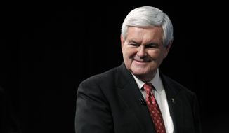Republican presidential candidate and former House Speaker Newt Gingrich walks Jan. 25, 2012, to a stage for a forum at Univision Network Studios in Doral, Fla. (Associated Press)