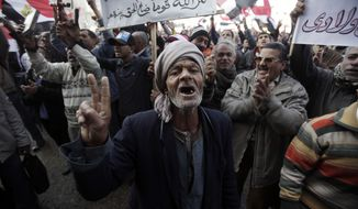 An Egyptian chants slogans as thousands gather in Tahrir Square in Cairo on Wednesday, Jan. 25, 2012, to mark the first anniversary of the uprising that ousted President Hosni Mubarak. (AP Photo/Muhammed Muheisen)
