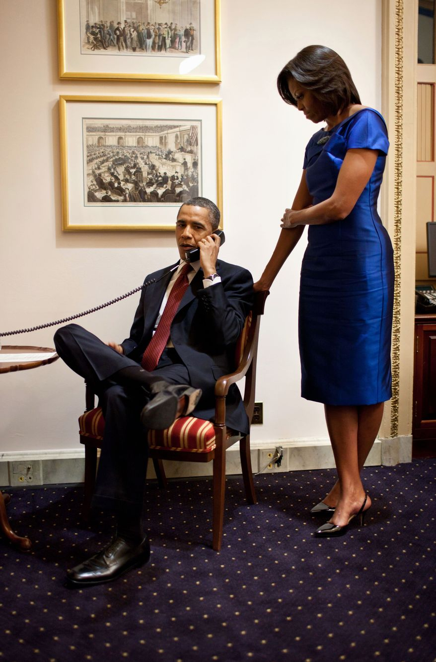 President Obama, accompanied by first lady Michelle Obama, makes a phone call Jan. 24, 2012, from the Capitol immediately after his State of the Union Address, informing John Buchanan that his daughter Jessica was rescued by U.S. Special Operations Forces in Somalia. (Associated Press/White House)