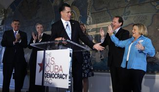** FILE ** Republican presidential candidate and former Massachusetts Gov. Mitt Romney campaigns on Jan. 25, 2012, at a U.S.-Cuba Democracy Political Action Committee (PAC) Event at Freedom Tower, at Miami-Dade College in Miami. Also onstage is (from right) Rep. Ileana Ros-Lehtinen, Florida Republican; former Florida Rep. Lincoln Diaz-Balart; Romney's wife, Ann; former Commerce Secretary Carlos Gutierrez; and former Florida Sen. Mel Martinez, Florida Republican. (Associated Press)