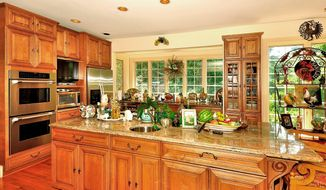 The kitchen has earth-tone granite counters, stainless steel appliances and a large center island.