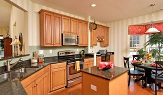The center-island kitchen in the Griffin model at the Legacy at Manning Village has an adjacent breakfast area.