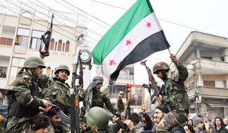 "Syrian army defectors celebrate with the Syrian revolution flag shortly after they joined the anti-regime protesters in Homs province on Thursday, the same day Syrian troops stormed a suburb of Damascus as the 10-month uprising inches ever closer to the capital. ""A fierce battle is taking place, and troops are shelling areas with heavy machine gunfire,"" an activist said. (Associated Press)"