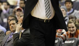Washington Wizards head coach Randy Wittman calls out to his players during the first quarter against the Charlotte Bobcats in Washington, Wednesday, Jan. 25, 2012. (AP Photo/Ann Heisenfelt)