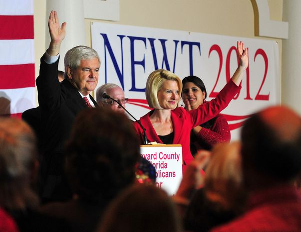 Republican presidential candidate and former House Speaker Newt Gingrich and his wife Callista wave Jan. 25, 2012, to the large crowd during a campaign stop in Cocoa, Fla. (Associated Press/Florida Today)