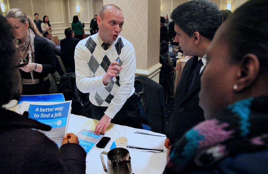 Jason Weinstein, an account manager for Workforce1 Healthcare, discusses job opportunities Jan. 25, 2012, with attendees at JobEXPO's job fair in New York. (Associated Press)