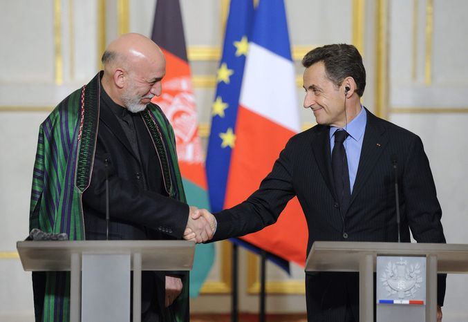 Afghan president Hamid Karzai, left, shakes hands with French President Nicolas Sarkozy following a news conference at the Elysee palace, in Paris, Friday, Jan. 27, 2012. (AP Photo/Eric Feferberg, Pool)