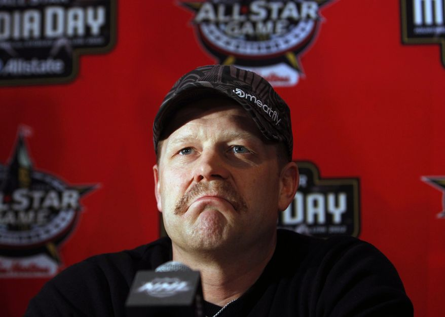 Boston Bruins goaltender Tim Thomas speaks to reporters during an NHL All Star hockey media availability in Ottawa, Ontario, Friday, Jan. 27, 2012. (AP Photo/The Canadian Press, Fred Chartrand)