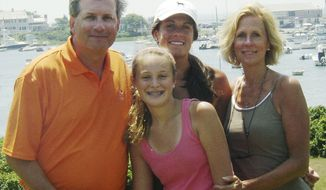** FILE ** This June 2007 file photo provided by Dr. William Petit Jr., shows Dr. Petit, left, with his daughters Michaela, front, Hayley, center rear, and his wife, Jennifer Hawke-Petit, on Cape Cod, Mass. Dr. Petit was severely beaten and his wife and two daughters were killed during a home invasion in Cheshire, Conn., July 23, 2007. (AP Photo/William Petit, File)