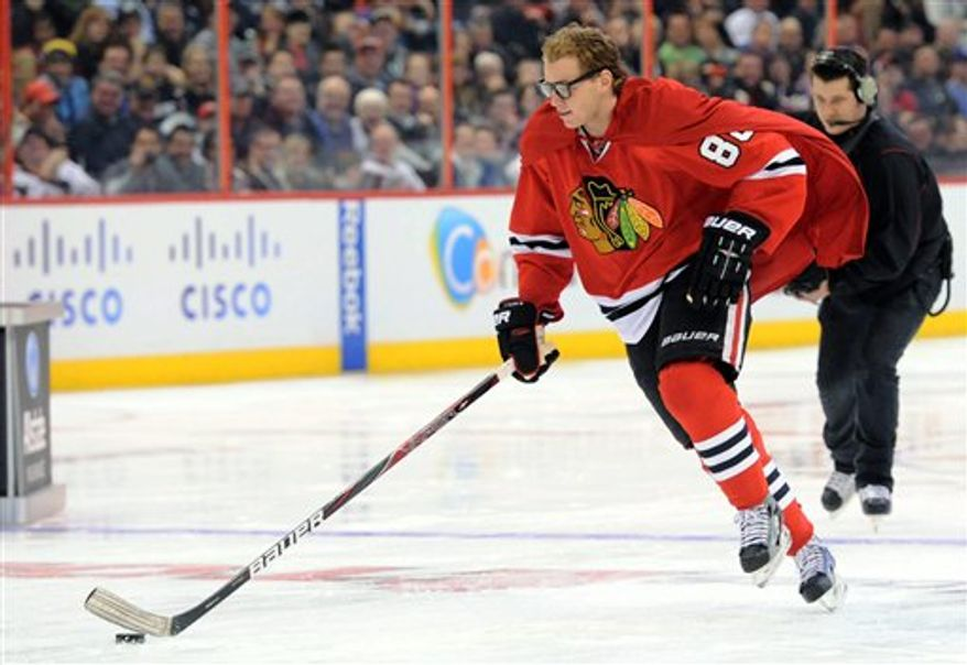 Patrick Kane, of the Chicago Blackhawks, wears a cape as he takes part in the breakaway challenge during the NHL All-Star skills hockey competition in Ottawa, Ontario, on Saturday, Jan. 28, 2012. (AP Photo/The Canadian Press, Sean Kilpatrick)