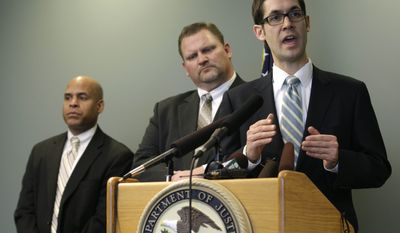Assistant U.S. Attorney Darwin Roberts, right, talks to reporters as Kelly Kneifl, center, who had his home broken into by Barefoot Bandit Colton Harris-Moore, and FBI Agent Steven Dean, left, look on, Friday, Jan. 27, 2012, following the federal sentencing hearing for Harris-Moore in Seattle. (AP Photo/Ted S. Warren)