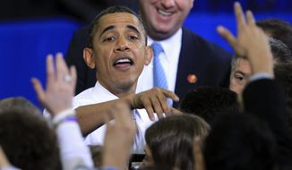 President Barack Obama greets supporters after his speech at the University of Michigan in Ann Arbor, Mich., Friday, Jan. 27, 2012. (AP Photo/Carlos Osorio)