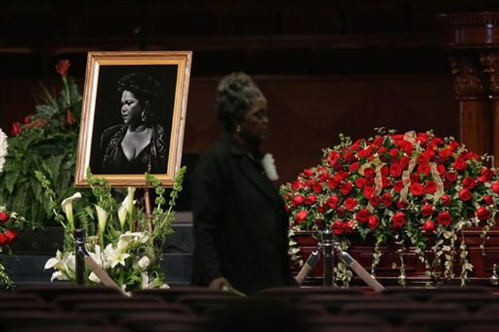 "Singer Etta James's picture is seen next to her casket during a funeral, Saturday, Jan. 28, 2012, at Greater Bethany Community Church City of Refuge in Gardena, Calif. James died last Friday at age 73 after battling leukemia and other ailments, including dementia. She was most famous for her classic ""At Last,"" but over her decades-long career, she became revered for her passionate singing voice. (AP Photo/Ringo H.W. Chiu)"