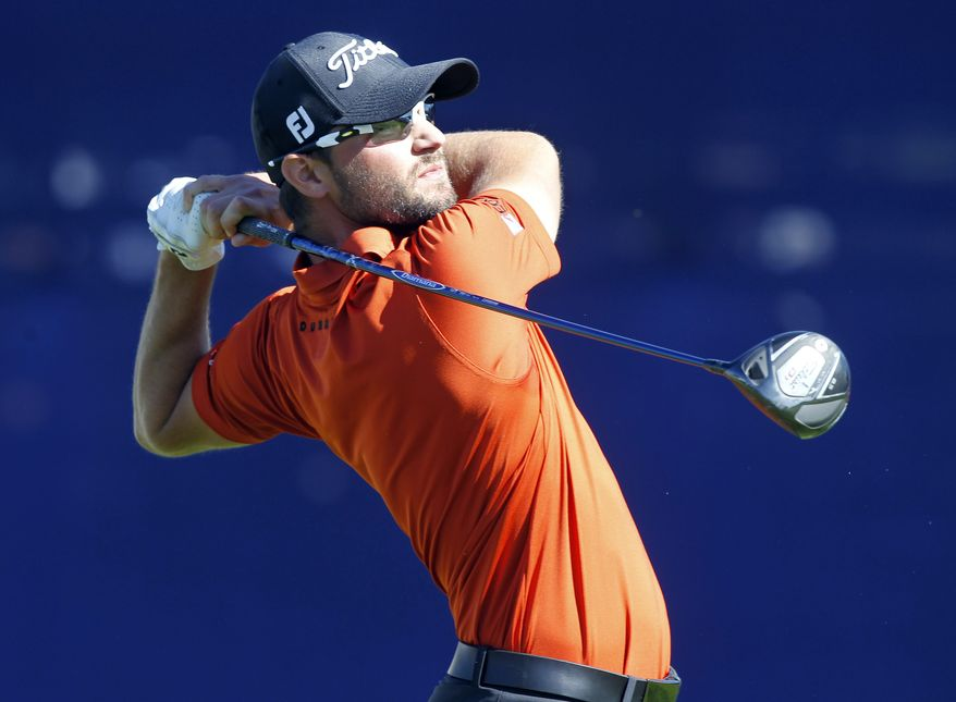 Kyle Stanley tees off on the seventh hole of the South Course at Torrey Pines during the third round of the Farmers Insurance Open golf tournament Saturday, Jan. 28, 2012 in San Diego. (AP Photo/Chris Carlson)