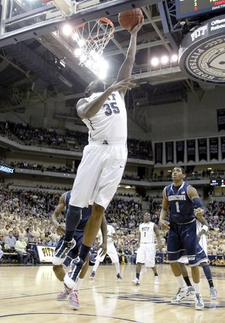 Pittsburgh's Nasir Robinson goes in for an easy layup in front of Georgetown's Hollis Thompson on Saturday, Jan. 28, 2012, in Pittsburgh. Pittsburgh upset ninth-ranked Georgetown 72-60. (AP Photo/Keith Srakocic)