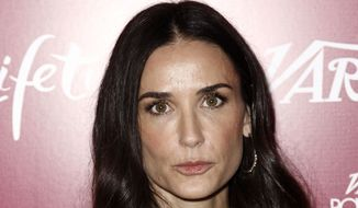 ** FILE ** Demi Moore arrives at Variety's 3rd Annual Power of Women Luncheon in Beverly Hills, Calif., in this Sept. 23, 2011, photo. (AP Photo/Matt Sayles)
