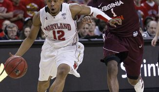 Maryland guard Terrell Stoglin drives past Virginia Tech guard Robert Brown in the second half in College Park, Md., Saturday, Jan. 28, 2012. Stoglin contributed a game-high 28 points to Maryland's 73-69 win. (AP Photo/Patrick Semansky)