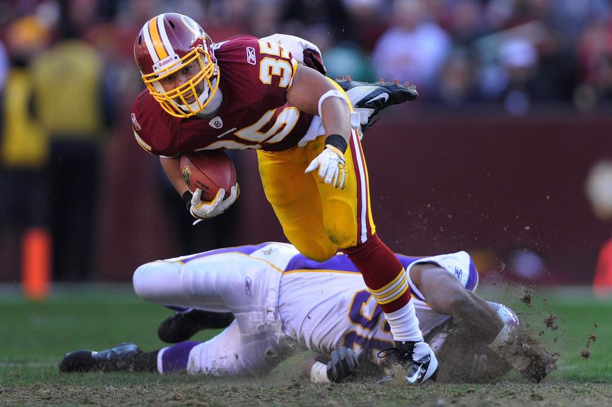 Washington Redskins running back Evan Royster (35) eludes Minnesota Vikings middle linebacker E.J. Henderson (56) on his way to a first down in the second quarter at FedEx Field in Landover, Md., on Saturday, December 24, 2011. (Preston Keres/Special to The Washington Times)