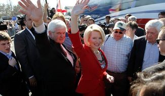 Former House Speaker Newt Gingrich, a Republican presidential candidate, and his wife, Callista, campaign at the Villages in Lady Lake, Fla., on Sunday. (Associated Press)