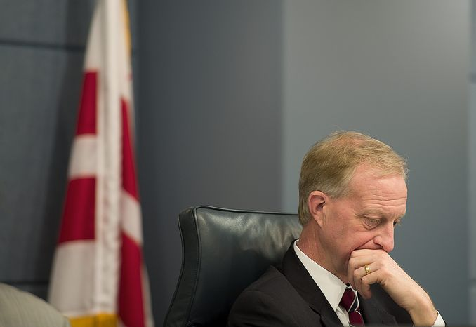 Jack Evans, chair of the D.C. Council Committee on Finance and Revenue, listens to tesitmony during a public oversight hearing Thursday, Jan. 26, 2012 on the matter of i-Gaming. (Barbara L. Salisbury/The Washington Times)