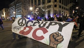 Occupy DC demonstrators protest against the Alfalfa Dinner at the Capitol Hilton in Washington on Saturday, Jan. 28, 2012. (AP Photo/Jose Luis Magana)