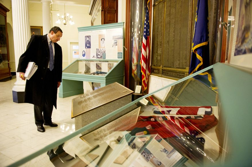 Washington Mayor Vincent C. Gray looks at the long history of the New Hampshire Statehouse while there to advocate for D.C. statehood. (Andrew Harnik/The Washington Times)