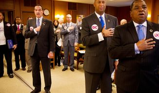 Washington Mayor Vincent C. Gray (from left) and D.C. Council members David Catania, Michael A. Brown and Vincent Orange stand for the Pledge of Allegiance before advocating for D.C. statehood in front of the New Hampshire House of Representatives Committee on State-Federal Relations and Veterans Affairs at the New Hampshire Statehouse in Concord, N.H., on Friday, Jan. 27, 2012.  (Andrew Harnik/The Washington Times)