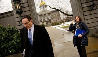 Washington Mayor Vincent C. Gray (left) and D.C. Council member Mary Cheh (right) head to vehicles outside  the New Hampshire Statehouse in Concord, N.H., on Friday, Jan. 27, 2012. (Andrew Harnik/The Washington Times)