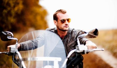 """Scottish photographer Francis Mathew, 33, has lived in the jungle, starred in Bollywood movies and trained as a stuntman. He is now the star of the second season of Ukraine's version of the popular U.S. show """"The Bachelor."""" (STB Channel via Associated Press)"""