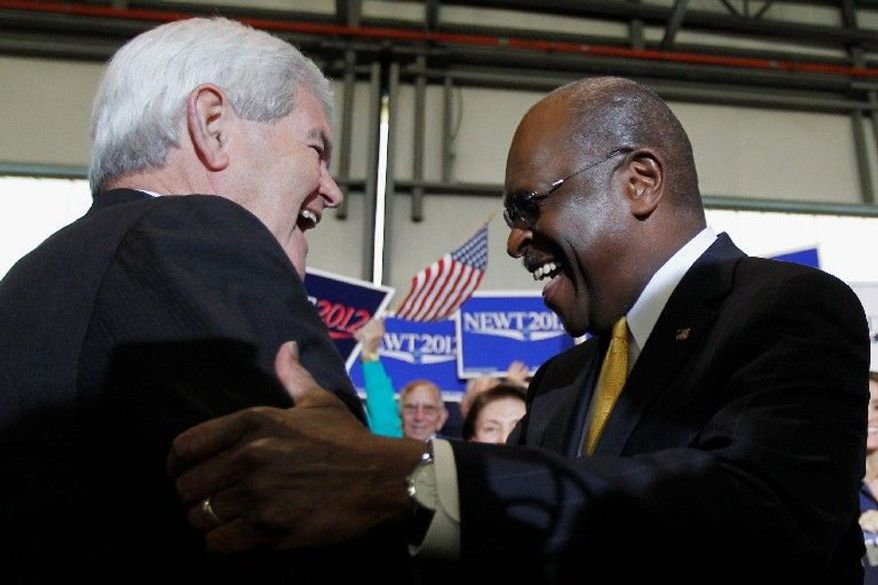 Former House Speaker Newt Gingrich greets former candidate Herman Cain during a campaign stop in Tampa, Fla., on Monday. Mr. Cain has endorsed Mr. Gingrich in the presidential race. (Associated Press)