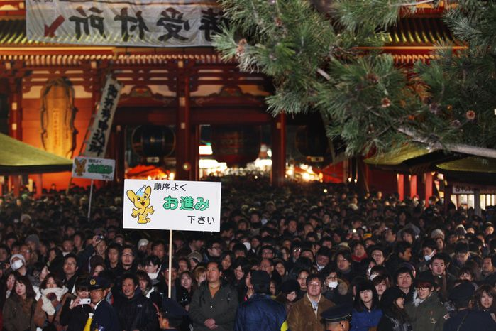 **FILE** Worshippers pack the compound of Sensoji temple on  Jan. 1, 2012, to pray in the hope of receiving a New Year's blessing in the Asakusa district in Tokyo. (Associated Press)